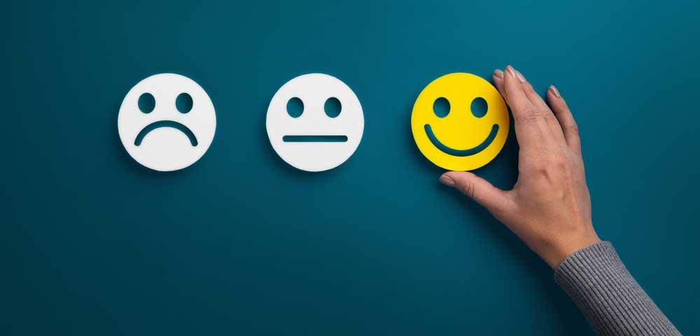 Foto mit Smileys mit traurigem und lachendem Gesicht